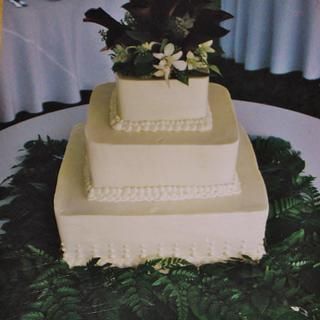 Square buttercream black calla lily wedding cake