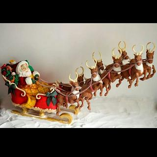 Santa with his flying reindeers