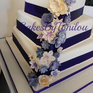 Cadburys purple wedding cake - Cake by CakesByTonilou