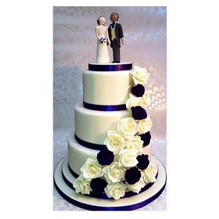 Cream and purple wedding cake