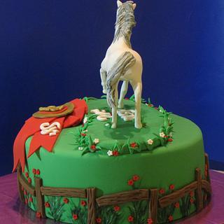 Handsculpted fondant horse cake