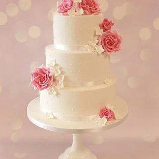 Three tier rose wedding cake