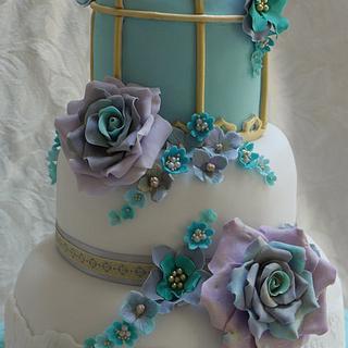 Lovebirds and birdcage golden wedding anniversary cake