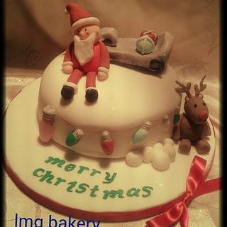 santa and rudolf Christmas cake