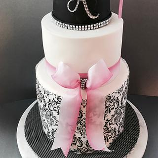 Pink and black graduation cake