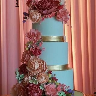 3 tiered cake with all handmade sugar flowers