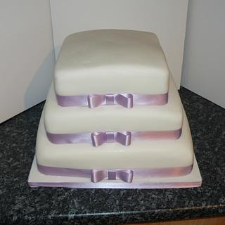 Plain 3tier square with lilac ribbons