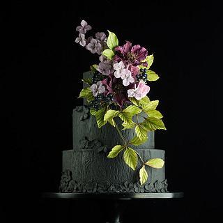 Black wedding cake with clematis sugarflowers