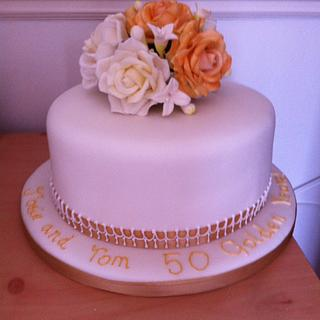 Golden wedding cake for Tom and Josie