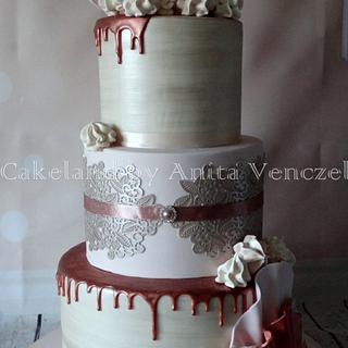 Rose gold wedding cake with lace and ruffles
