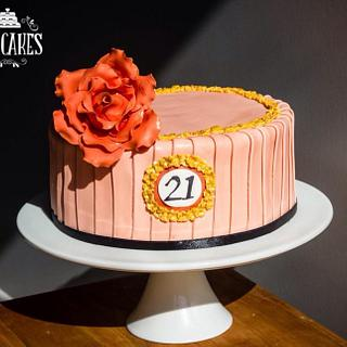 21st cake in peach and corals