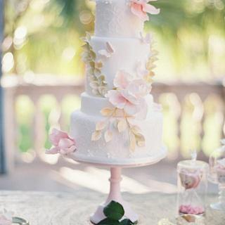 Romantic wedding cake and dessert table