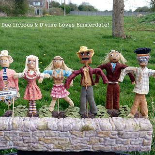 Emmerdale Scarecrows looking after a mud cake (of course!)