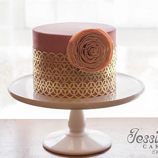 Gold leaf and ruffle flower birthday cake