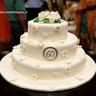 3 layer designer cake with white flowers for 60th anniversary