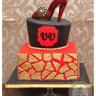 Red, Black and Gold Cake with a shoe