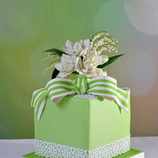 cake with lace, gardenia and lily of the valley