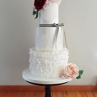 Delicate shimmer & ruffled wedding cake