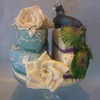 Peacock and roses split cake.
