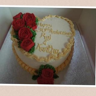 Heart shaped cake decorated with buttercream roses