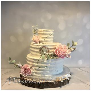 Weddingcake with roses of cold porselain...