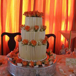 white chocolate wedding cake with fresh roses