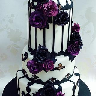 Black and purple roses wedding cake