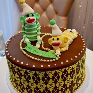 Sock monkey baby shower cake