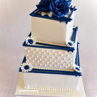 Wedding cake with blue roses