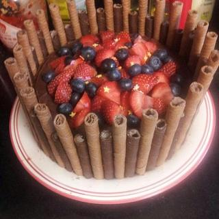 chocolate cake with cigarellos and fresh berries