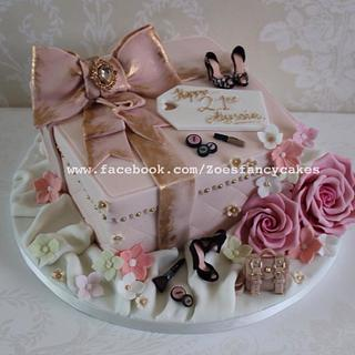 Pink themes present cake including shoes, flowers and mulberry bag
