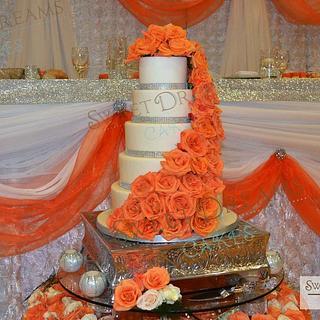 Orange roses wedding cake.