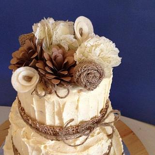 Rustic buttercream cake with paper flowers