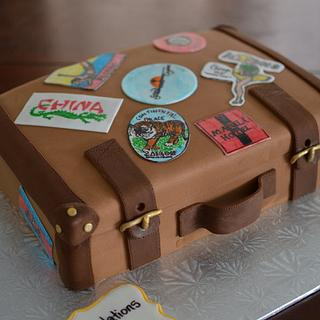 Suitcase cake with hand drawn luggage stickers