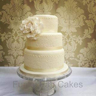 Ivory wedding cake with lace and sugar peony