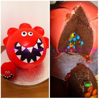 Comic relief red nose piñata cake