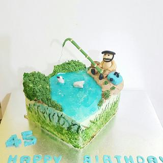 Fishing theme cake and edible discus crispy treat