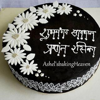 Dark chocolate ganache cake with flowers