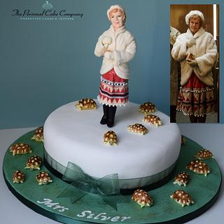 Judi Dench in 'Esio Trot' with a cake full of tortoises