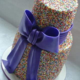 Sprinkles and a purple bow