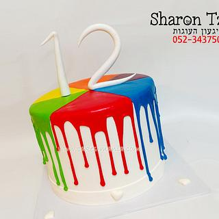 dripping cake rainbow colors