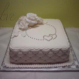White cake with diamond side design
