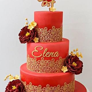 Red and gold longevity cake