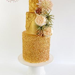 Golden Wedding Cake with roses, dahlia and succulents.