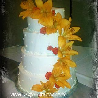 Simple 4 Tier Wedding Cake with Lillies and Roses