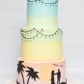 Pastel rainbow silhouette wedding cake