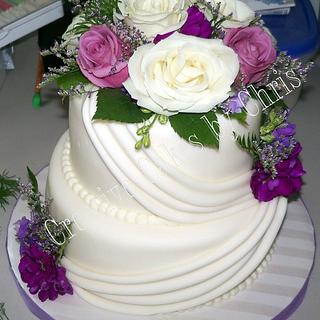 Swag Wedding cake with fresh flowers