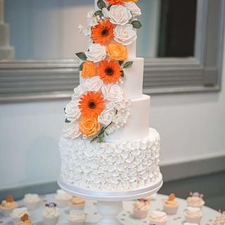Rose and gerbera cascading wedding cake