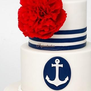 Navy themed wedding cake with red peonies