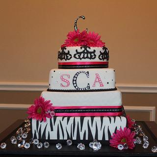 Hot pink and animal print wedding cake
